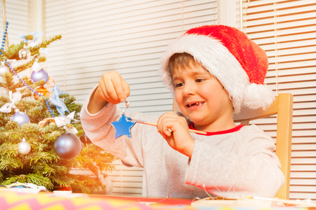 Boy preparing handmade Christmas ornaments