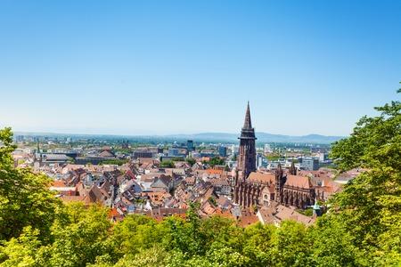 Freiburg im Breisgau cityscape with Munster towers against blue sky, Germany, Europe