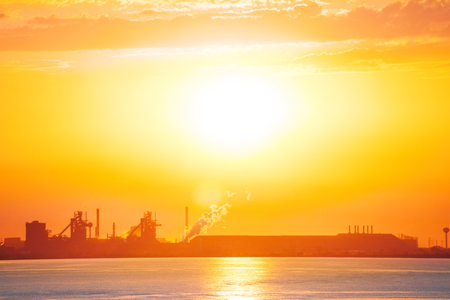 Panoramic view of Port-de-Bouc skyline with petrochemical platform silhouette during sunset