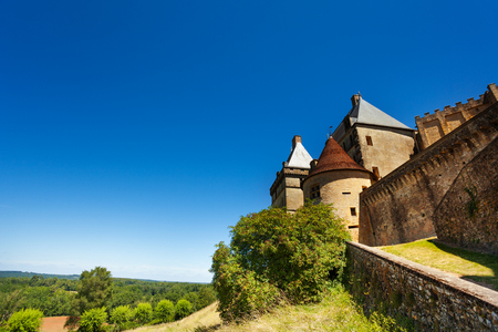 Medieval Biron castle against blue sky, France
