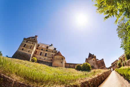 View of Chateau de Biron castle at sunny day