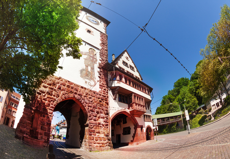 Schwabentor city gate with archway and clock tower