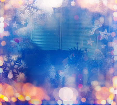 View to Christmas decorated room through  window