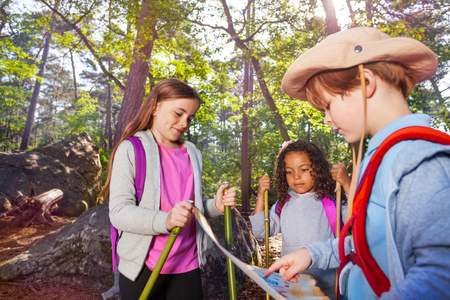 Three little kids reading orientation map