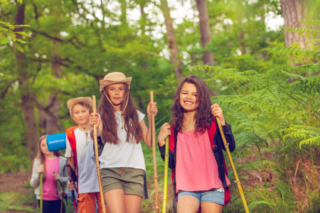 Group portrait of kids hiking in the forest