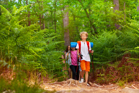 Group of kids boys and girls on hiking trail