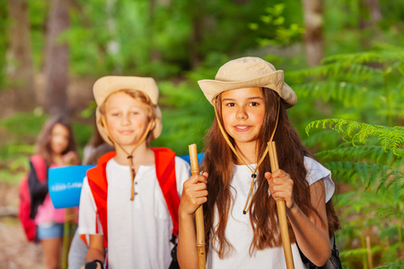 Close portrait of girl in hiking activity group