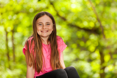 Portrait of smiling girl in the forest