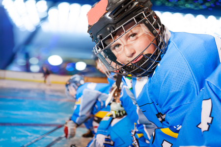 Portrait of happy boy in ice hockey uniform