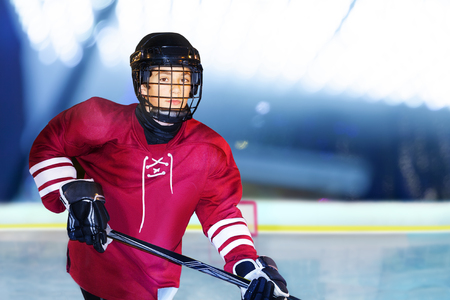 Portrait of teenage boy playing ice hockey