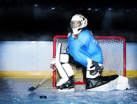 Girl goaltender protecting net during hockey match Stockfoto