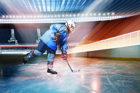 Hockey player passing the puck at ice stadium Stock Photo