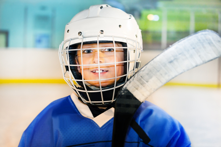 Happy hockey player preparing to go out on the ice Stock Photo