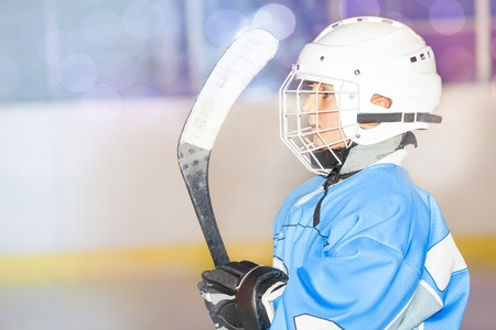 Young hockey player preparing to go out on rink Stock Photo