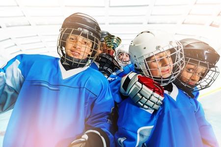 Childrens ice hockey team celebrating victory