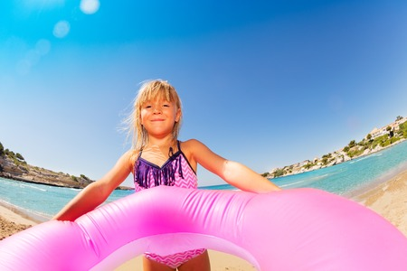 Adorable little girl ready for sea swimming Stock Photo