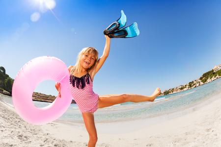 Happy girl enjoying summer vacation by the sea