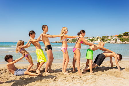 Friends playing beach games during summer vacation
