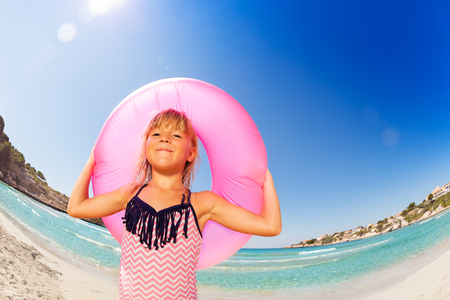 Happy little girl with rubber ring at the seaside Standard-Bild
