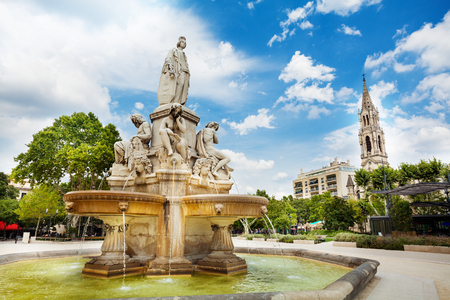 Fountain and Church of Sainte Perpetue in Nimes Stock Photo