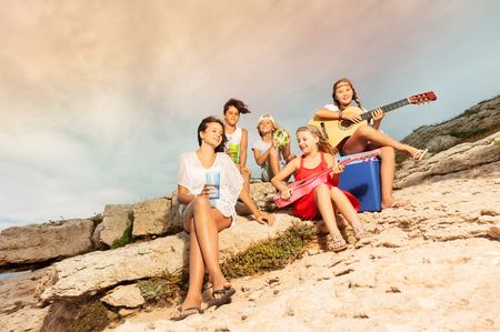 Group of musicians having fun outdoors in summer Stock Photo