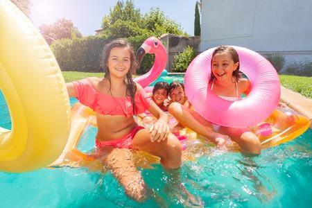 Joyful teens having pool party during summertime