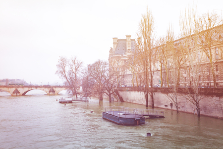 Quayside of Seine river in winter, Paris, France