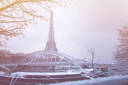 Debilly footbridge and the Eiffel Tower in snow