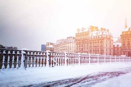 Snow-covered bridge across the Seine river, Paris Stock Photo
