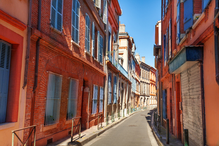 Brick houses on narrow street of Toulouse, France Stock Photo