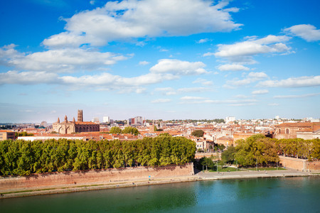 Embankment of Garonne river and Toulouse cityscape