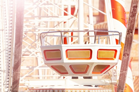 Empty observation wheel cabin at sunny day