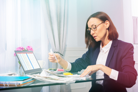 Business woman doing paperwork in the office