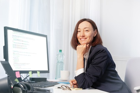Happy woman working with computer in the office