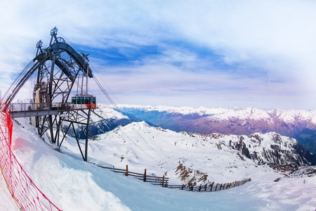 Scenic view of Les Arcs ski resort with clouds, cable car and mountains, France, Europe Reklamní fotografie - 116101046