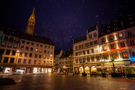 Beautiful cityscape of Strasbourg with the Cathedral Notre Dame steeple against starry night sky