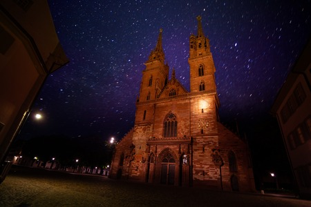 Bottom view of the Minster cathedral against starry sky in Basel, Switzerland Stock Photo