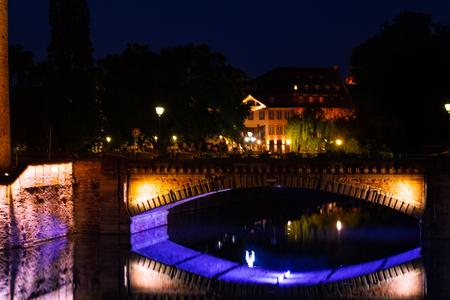 Illuminated Ponts Couverts at Grande Ile island at night, Strasbourg Reklamní fotografie - 116123220