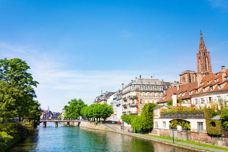 Beautiful view of the Ill river embankment with Notre dame de Strasbourg cathedral in spring, France, Alsace