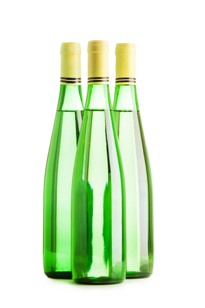 Three wine bottles group isolated on white