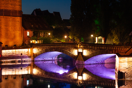 Illuminated Ponts Couverts reflected in Ill river Reklamní fotografie