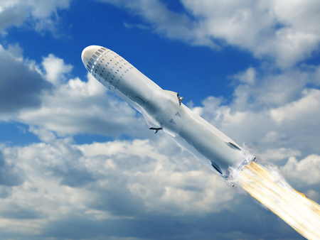 Big rocket flying over blue sky clouds