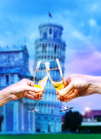 Pisa Italy tower with glasses of champagne