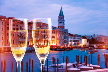 Venice, Italy canals with glasses of champagne