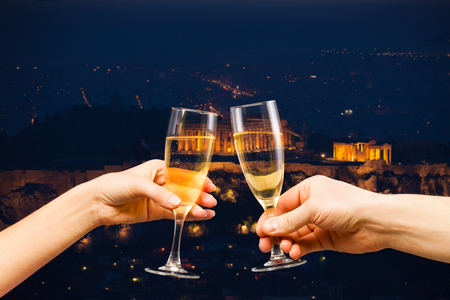 Athens Greece at night with glasses of champagne