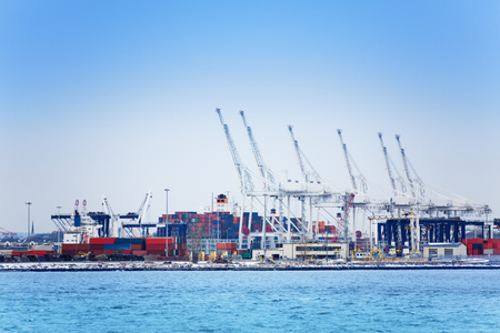 Marine cranes and containers at maritime port 写真素材