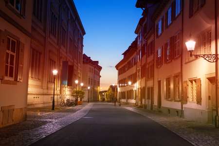 Street lights of Basel old city during sunset Stock Photo