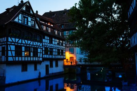 Ill river embankment at sunset, Strasbourg, EU