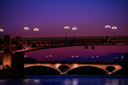 Garonne river with illuminated bridges at night