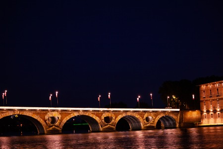 Night view of Garonne river with Pont Neuf bridge